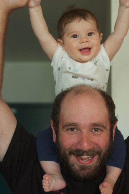 Miles rides his dad's shoulders